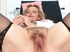 Mature slut takes her clothes off and masturbates in office