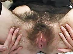 Skinny looking brunette slut shows her hairy love tube solo